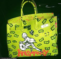 Custom painted: Khloe Kardashian shared a photo of her newestHermès Birkin bag that was painted by graffiti artist Alec Monopoly on her Instagram account on Friday