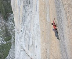 Alex Honnold free base rock climbing on Half Dome at Yosemite. He climbs without the use of ropes.