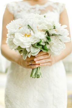 A fresh white bouquet: http://www.stylemepretty.com/2016/06/20/steal-the-look-morgan-stewarts-glam-all-white-wedding/