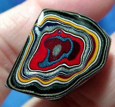 This is amazing! Look at the colors here. A solid Detroit Agate / Fordite Cabochon.