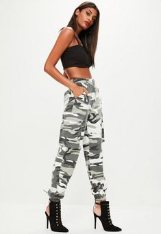 8e2f278e840e8 Grey camo trousers featuring two side pockets with button fastening