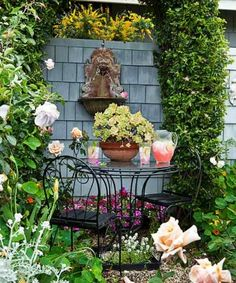 Garden Beauty on a Budget This iron bistro set, shielded from the street by a shingled privacy scree Cozy Patio, Backyard Patio, This Old House, Pocket Garden, Iron Pergola, Garden Yard Ideas, Patio Ideas, Backyard Ideas, Budget Patio