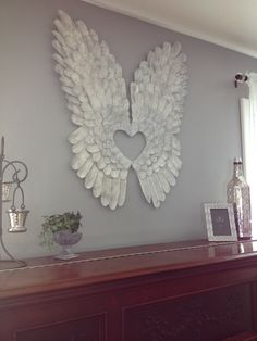 Angel wings made out of cardboard painted white and dry brushed them grey.