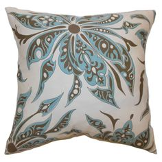 This striking floral throw pillow displays a rich and exquisite pattern in Aqua Blue and Cocoa Brown hue. The neutral hues are versatile and match various interior themes.