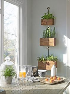 These hanging wood boxes are a unique idea for herbs and plants that prefer part shade over direct sun.