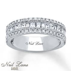 Baguette and princess-cut diamonds distinguish the center row of this lovely anniversary band from the Neil Lane Bridal® collection. Round diamonds above and below provide splendid contrast. Crafted of 14K white gold, the band has a total diamond weight of 1 1/4 carats. Neil Lane Bridal® rings are handcrafted and undergo a four-step polishing process to give each ring its beautiful shine and luster. Neil Lane's signature appears on the inside of the band. Diamond To...