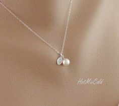Silver Monogram Pendant Necklace, Pearl Initial leaf Necklace, Charm Jewelry, Child, Simple Bridesmaid necklace, Flower girl Gift. $23.00, via Etsy.