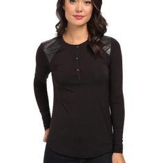 NWT Calvin Klein Black Henley Elevate your casual wardrobe with this stylish henley. Slim silhouette. Soft woven body fabric is accented with polyurethane snakeskin paneling at front shoulders and back yoke. Three-button henley placket. Long sleeves. Brand tag at left seam. High-low hemline.no trades. Generous discount with bundle. Calvin Klein Tops Tees - Long Sleeve