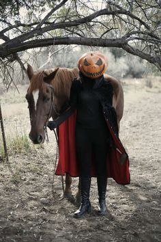 headless horsewoman (if i had a horse i would totally dress up and ride about the neighborhood like this)