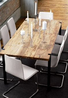CB2's Darjeeling Table. love the rustic wood with modern chairs.