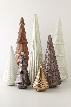 These metallic Christmas trees are perfect for your holiday table as a centerpiece or on top of your mantel with garland.