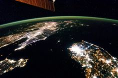 The darkness of North Korea. Flying over East Asia, an Expedition 38 crew member on the ISS took this night image of the Korean Peninsula on January 30, 2014. Unlike daylight images, city lights at night illustrate dramatically the relative economic importance of citie