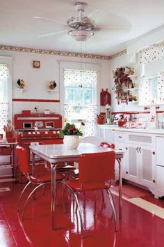 love the red and white kitchen!