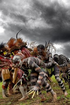 Snake men crossing the Huli men. Papua New Guinea Papua New Guinea , Highlands, Mount Hagen festival singsing The men-with-wigs are the members of the Huli tribe. It is the most famous famous tribe of Papua New Guinea. They are called like that because they make wigs from their hair. They live close to Tari city in the center of the Papua New Guinea on the top of the Highlands.