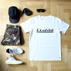 Outfitgrid - Wood Wood tee / Carhartt shorts / Raised By Wolves cap / adidas x Pharrell Tennis Hu shoes.