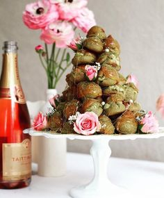 A flower studded Matcha Croquembouche Tower and sparkling glass of @taittingerusa rosé to finish off the weekend  These little dream puffs are filled with matcha laced cream. Perfect for a bridal shower or springtime brunch! by jewelsofny