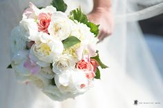 Clutch of peonies, roses, hydrangea and dendrobium orchid blooms - Photographed by The Beautiful Mess Photography