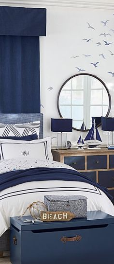 This intricately upholstered bed and headboard feature a simple yet elegant silhouette. Designed with renowned fashion designer Monique Lhuillier, it marries functionality with her contemporary, whimsical and magical design aesthetic. Boys Nautical Bedroom, Nautical Bedding, Nautical Headboard, Nautical Cake, Vintage Nautical, Beach House Bedroom, Beach House Decor, Beach Theme Rooms, Blue Headboard