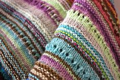 scrappy shawl, great way to use leftover yarn #knitting - no pattern, just random rows of stitching with scraps of yarn