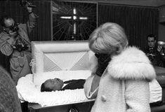 An unidentified woman weeps at the R.S. Lewis funeral home in Memphis, Tenn., as hundreds of mourners filed past the body of civil rights leader Dr. Martin Luther King, Jr., April 5, 1968, before it was to be sent to Atlanta for burial.  (AP Photo/Charles Kelly) Photo: CHARLES KELLY, STF / Beaumont