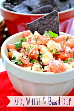 Tomatoes, feta cheese, basil, and Greek dressing - a quick, easy, and delicious summer dip, straight from the garden...and just in time for your Memorial Day
