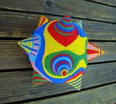 Bead-embroidered ball by Judy Tepley (starhandarts)
