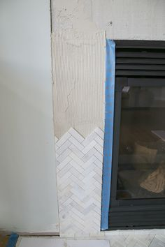 Installing marble herringbone tile fireplace surround