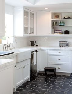 black Moroccan style tiles for a mid century modern kitchen with white cabinets