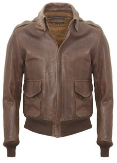 Anniversary edition A2 jacket. Worn by USAAF fliers in the early 1940s, and created from the original Schott NYC government contract pattern. This piece is made in brown oil tanned, hand waxed lambskin with mil spec cotton lining and knit waistband and cuffs. Made in USA.