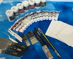 Win $300 worth of Fluid Acrylics, Paint Markers, Watercolors & Surfaces