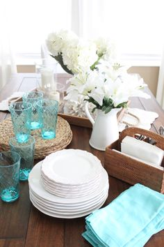 A causal tablescape with thie and touches of turquoise   Starfish Cottage
