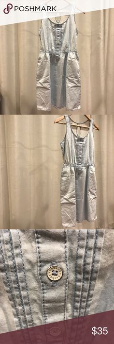 Garage Montreal Canada lace back denim dress Garage Montreal Canada lace back denim dress; one pocket on each side; brand new with tags, no price tags, never used. Cotton, machine wash cold Garage Dresses Midi