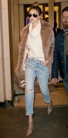 Leave it to Gigi Hadid to master cold-weather style like a pro—she was snapped in Paris in a slouchy cowl-neck ivory One x OneTeaspoon knit half-tucked in a pair of destroyed cropped jeans that she styled with mirrored aviators, a furry camel Katie Ermili
