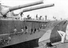 German Battleship Bismarck receiving dazzle camouflage paint at Kiel, Germany in 1941.