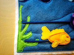 Make this quiet book felt page with a step-by-step picture tutorial. Children can make Jesus walk across the water and have fish swim between seaweed.