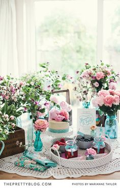 Quirky tea table   Flower arrangements   Blue & Pink theme   Roses   Photography by Marianne Taylor Photography