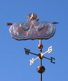 Military Banner Weather Vane by West Coast Weather Vanes.  This handcrafted Military Banner weathervane can be customized  using a variety of military symbols and materials.