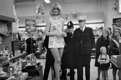 Ann Bramball models a dress made of money in a Manchester store in 1969