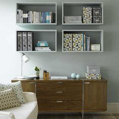 Wall-mounted cubbyhole-style shelves create a focal point. (Painted same color as walls here...)