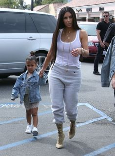 Reality stars Kim, Kourtney and Khloe Kardashian film their reality show 'Keeping Up With The Kardashian's' in Los Angeles, California on March 10, 2017. The family took Kim's daughter North and Kourtney's daughter Penelope to Color Me Mine for the show.