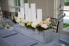 Candle and floral, rustic centerpiece by Southern Event Planners, Memphis, Tennessee.