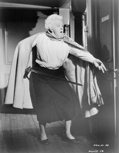 Margaret Rutherford as Miss Marple.