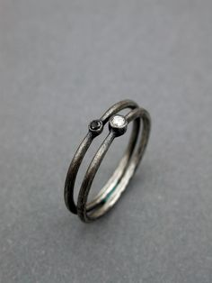 white diamond black diamond rings simple sterling silver. $380.00, via Etsy.