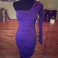 New purple one shoulder dress New without tags purple party dress. Very sexy and has amazing shoulder detail. Smoke free home. Total length is 33 inches from the top of the left shoulder. From the right sleeveless side it's 27 inches. City Triangles Dresses Mini