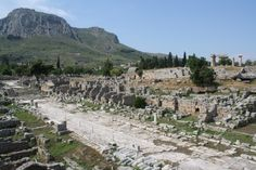 Agora, Corinth. A general view of the agora of ancient Roman Corinth with the Lechaion road, lined with remains of stoas and shops. In the background can be seen the acrocorinth, site of the ancient acropolis.
