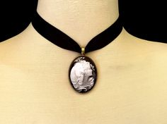 Horse jewelry for the horse lover!!!  Black and white vintage girl with horse choker necklace....  This unique, black satin ribbon choker is the perfect gift for any horse lover - young and old!  Also a lovely gift for your devoted veterinarian!  A great gift for that special birthday!  This pendant is reversible - the image of the girl with her horse is black and white and protected with a quality glass dome - the pendant is antique bronze and the reverse side is an intricately carved…