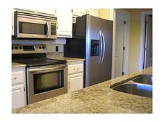 Spacious kitchen with stainless steel appliances and LOTS of counter space Stainless Steel Appliances, Kitchen Appliances, Lakefront Homes For Sale, Real Estate Buyers, Granite Counters, Counter Space, Breakfast Nook, Arkansas, Family Room