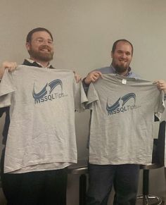 Members of the Baton Rouge SQL Server Users Group proudly holding thier new t-shirts.