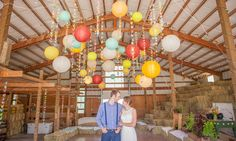 wide shot of overhead decor  Laura & Mitchell Wedding Photo By Tiffany Burke Photography