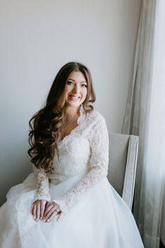 This traditional wedding dress with lace sleeves is inspired by Kate Middleton. The royal wedding dress overlay cascades down the ball gown wedding dress. #royalweddingdress #weddingdress #wedding #laceweddingdress #longsleeveweddingdress #bridalgown #bride #katemiddleton